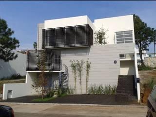 Gil + Gil : Casas de estilo  por GIL+GIL,