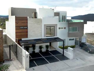 Casas unifamilares  por Ambás Arquitectos,