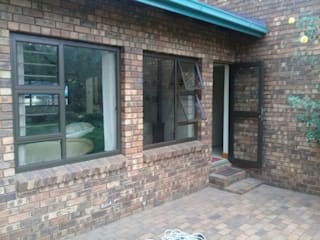 STEEL TO ALUMINIUM CONVERSION by ALUWOOD WINDOWS AND DOORS