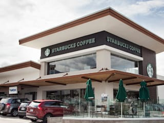 Starbucks Coffee: Locales gastronómicos de estilo  por Smart Investment Group, Moderno