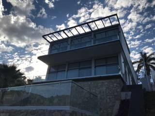 RESIDENCIA ¨LAS CAÑADAS ANCAR & ARQUITECTOS Balcón Vidrio Transparente