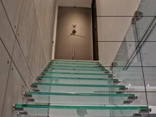 DEPARTAMENTO TORRE AURA ANCAR & ARQUITECTOS Escaleras Vidrio Transparente
