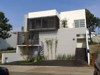 Casas multifamiliares de estilo  por GIL+GIL, Moderno