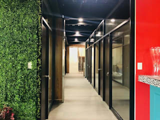 by PISO 77 BUSINESS CENTER + COWORKING