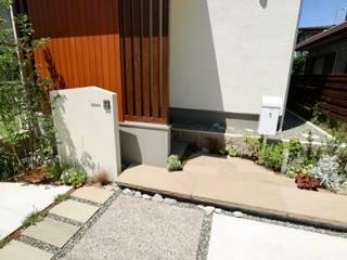 静寂感とリズム感を共存させたナチュラルモダンエクステリア: 株式会社Garden TIMEが手掛けた家です。,