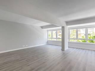 Apartamento Portela I Salas de estar modernas por Archimais Moderno