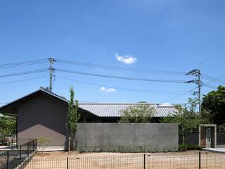 Casas de estilo asiático de Atelier Square Asiático