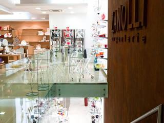 Gioielleria storica su 2 piani: Negozi & Locali commerciali in stile  di MARIA QUATTRINA, Moderno