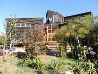 Casa Molle : Casas de madera de estilo  por MMS Arquitectos, Moderno