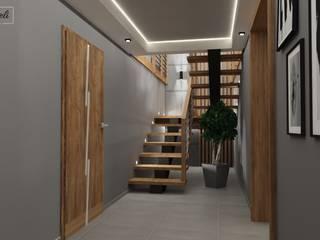 Projekt salon parter klatka schodową i drugi salon na piętrze : styl , w kategorii Schody zaprojektowany przez Dekoreveli Pracownia Projektowa,
