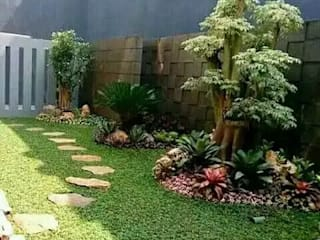 Tropical style garden by Tukang Taman Surabaya - Tianggadha-art Tropical