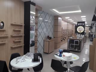 Ótica VYX Espaços comerciais modernos por Marcenaria Conceito Concreto Moderno
