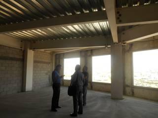 Construcción de Oficinas Queretaro: Estudios y oficinas de estilo  por Proyectos y Construcciones R S L,
