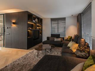 Lichtplan voor een nieuwbouw woning in Tilburg:  Woonkamer door Hannie Verhoeven Lichtadvies, Modern