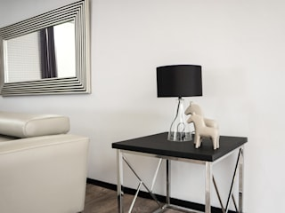 Como crear ambientes con iluminación: Pasillos y recibidores de estilo  por Muebles Dico, Moderno