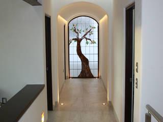 Pasillos, vestíbulos y escaleras eclécticos de Rabell Arquitectos Ecléctico