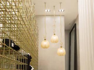Oficinas y tiendas de estilo moderno de T + T arquitectos Moderno