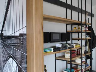 Departamento DLH Livings modernos: Ideas, imágenes y decoración de T + T arquitectos Moderno