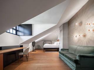 EXMO HOTEL Hotéis eclécticos por Floret Eclético