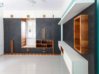 Wardrobe & the TV Unit in the Master Bedroom: modern  by U and I Designs,Modern