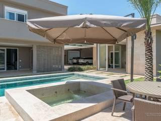 Residência M|C Piscinas modernas por Marcos Baldasso Arquitetura Moderno