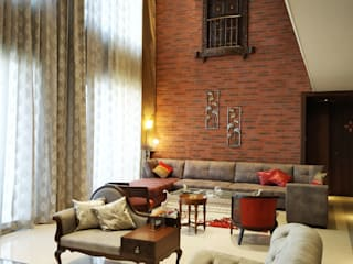 The Living room with the traditional Jharoka Rustic style living room by AR. AISHANI KUMBHANI Rustic Bricks