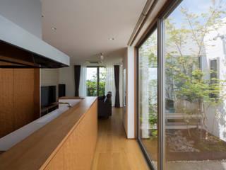 Cocinas de estilo moderno de TRANSTYLE architects Moderno