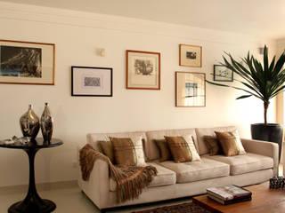 Apto. CL - Alto de Pinheiros Célia Orlandi por Ato em Arte Salas de estar modernas