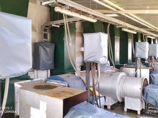 Cobertores maquinaria industrial: Espacios comerciales de estilo  por CarpasLircay.cl, Industrial
