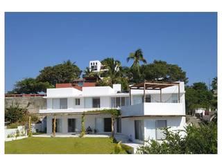 AWA arquitectos Case in stile mediterraneo Laterizio Bianco
