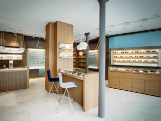 Alessandra Pisi / Pisi Design Architetti Offices & stores Wood Multicolored