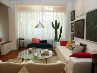 Apartamento RHL: Salas de estar  por Viviane Cunha Arquitectura,Moderno