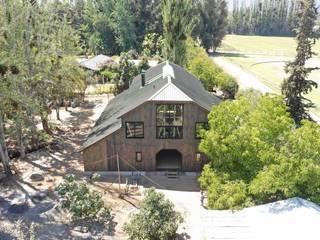 Casa Galpón: Casas de madera de estilo  por Jose Fontecilla Figueroa, Rural