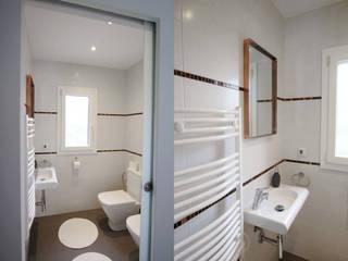 Design und Renovierung eines Badezimmers en suite in Cala Murada, Mallorca ENVIVIR INTERIORISMO Y REFORMAS S.L. Klassische Badezimmer