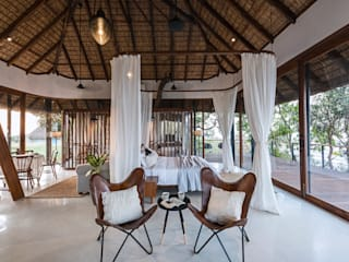 Tala Treehouse Villa Tropical style bedroom by Architecture BRIO Tropical