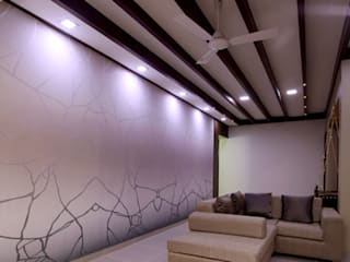 Interior for a 2 bhk:  Living room by Ideation Designs,Modern