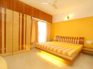 Interior for a 2 bhk:  Small bedroom by Ideation Designs,Modern