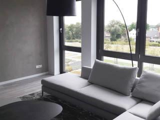 Ruang Keluarga Modern Oleh Meer met interieur Modern