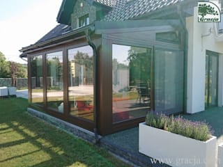 Classic style conservatory by GRACJA SP. Z O.O. Classic