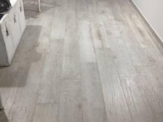 Salas de estar modernas por Dedalo Ceramiche Srl Moderno