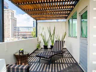 emARTquitectura Arte y Diseño Balkon, Beranda & Teras Klasik Keramik Beige