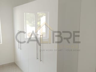 High Gloss mirror finish wardrobes by Calibre livings Modern