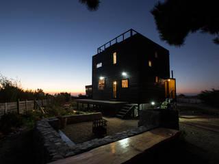 Casa Cubo: Casas de madera de estilo  por Irene Escobar Doren, Minimalista