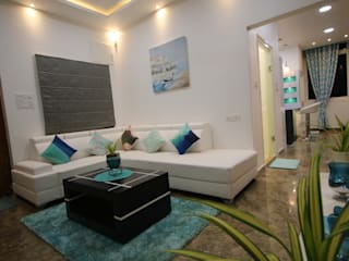 Elegant Styled Vibrant 3BHK Project @ Alwal Modern living room by Enrich Interiors & Decors Modern