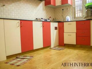 Simple and Spacious Apartment: minimalist  by Ajith interiors,Minimalist