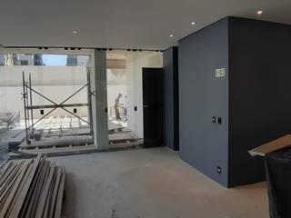 Reforma em apartamento ISG Engenharia Salas de estar minimalistas