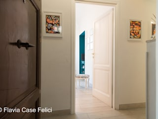Modern Corridor, Hallway and Staircase by Flavia Case Felici Modern