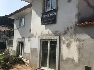 Reconstrução de Moradia no Estoril: Casas unifamilares  por NWORKS Engenharia,Clássico