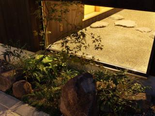 床座の家-土間と離れ蔵のある家- アジア風 庭 の Studio tanpopo-gumi 一級建築士事務所 和風