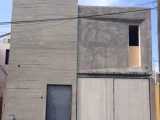 Kleines Haus von MIDA , Minimalistisch Beton